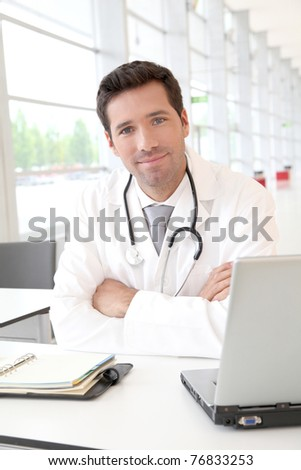 Portrait of young doctor at work