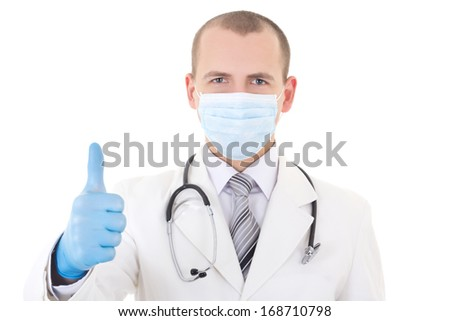 portrait of young doctor in mask and blue gloves thumbs up isolated on white background - stock photo