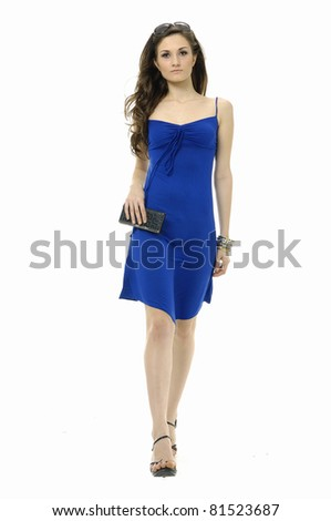 Portrait of young elegant sexy woman in blue dress posing on white background.