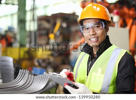 Portrait of young engineer taking notes