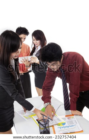 Portrait of young entrepreneurs discussing financial report in business meeting  - stock photo