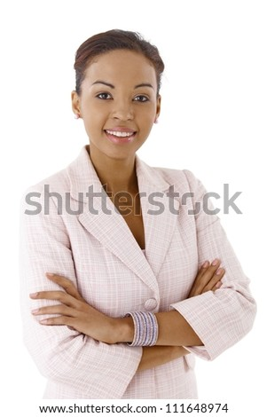 Portrait of young ethnic businesswoman smiling at camera confidently with arms crossed. - stock photo