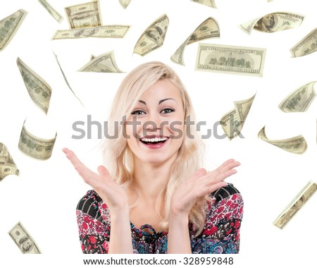 Portrait of young excited woman under a money rain - isolated on white background