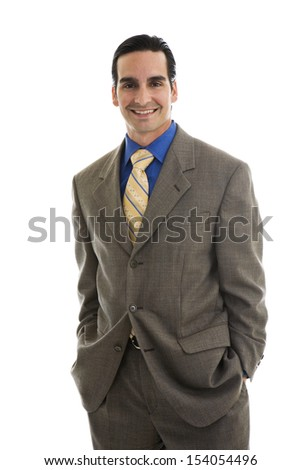 Portrait of young executive with hands in pockets, smiling, isolated on white background