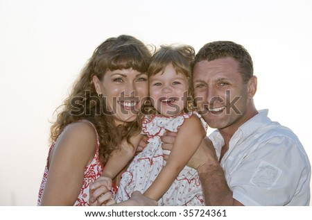 Portrait of young family having fun on white back