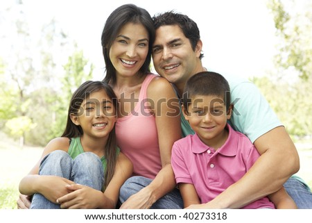 Portrait Of Young Family In Park - stock photo