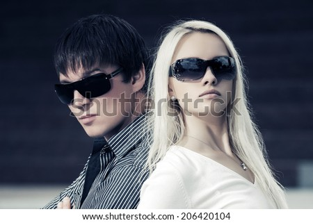 Portrait of young fashion couple outdoor - stock photo