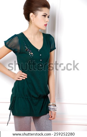 portrait of young fashion model posing in studio - stock photo