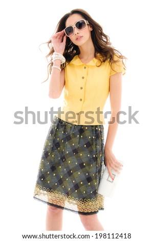 portrait of young fashion model wearing sunglasses posing  - stock photo