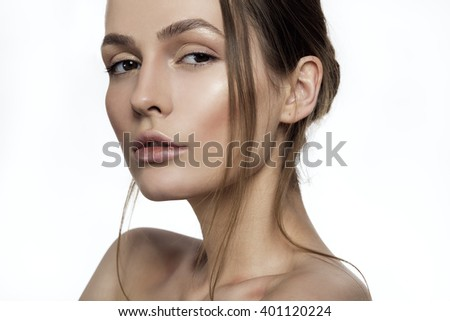 Portrait of young fashion model woman with clean fresh skin close up on white background - stock photo