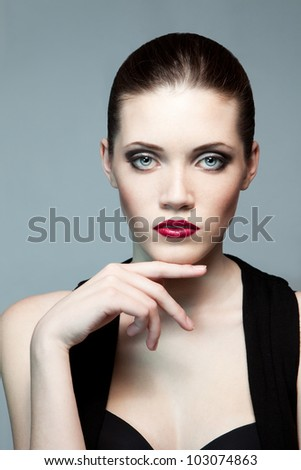 Portrait of young fashion woman with dark make-up