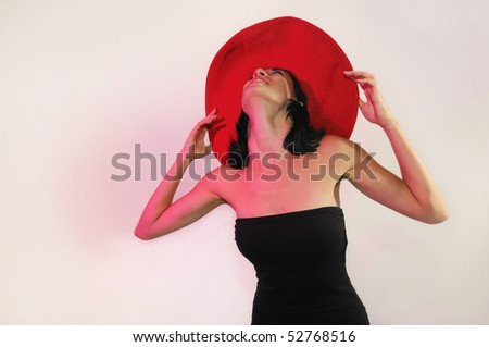 Portrait of young fashionable woman wearing red hat isolated on white - stock photo