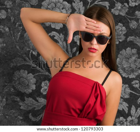 Portrait Of Young Fashioned Woman Gesturing against a vintage background
