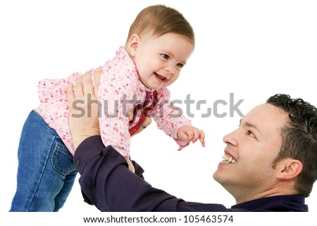 Portrait of young father having fun with his baby daughter. Isolated on white background.