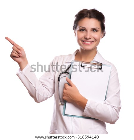 Portrait of young female doctor showing something or copyspase for product or sign text, - stock photo
