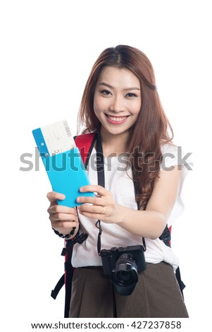 Portrait of young female holding the tickets with passport isolated on white background - stock photo