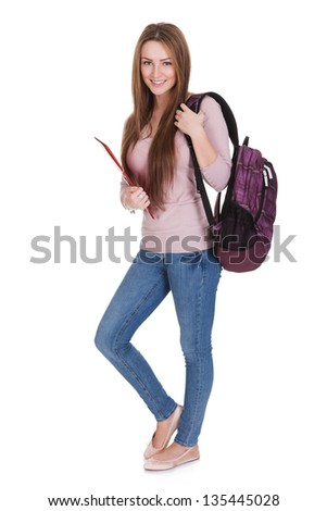 Portrait Of Young Female Student Isolated On White Background - stock photo