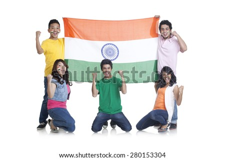 Portrait of young friends with Indian flag cheering together over background - stock photo