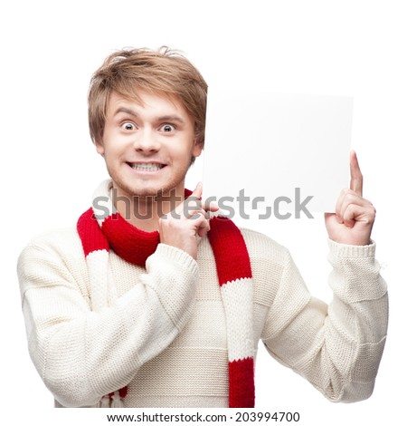 portrait of young funny cheerful caucasian man which holding sign with funny expression - stock photo