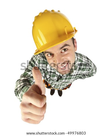 portrait of young funny handyman thumb up - stock photo