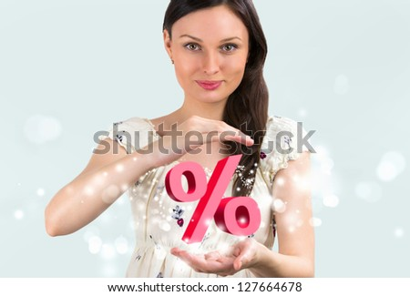 Portrait of young girl holding discount symbol in her arms