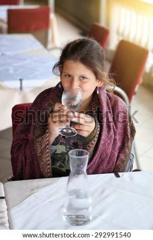 Portrait of young girl holds a glass with water - stock photo