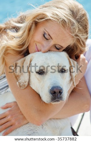 Portrait of young girl hugging her dog - stock photo