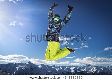 Portrait of young girl in a winter ski sports outfit in Grossglockner Alps - stock photo