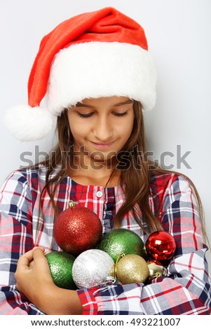 Portrait of young girl in santa claus hat