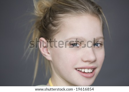 Portrait of young girl in studio - stock photo