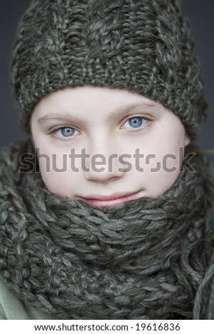 Portrait of young girl in winter apparel - stock photo