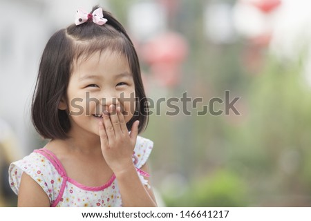Portrait of Young Girl Laughing in Nanluoguxiang, Beijing, China
