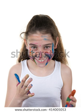 Portrait of young girl messed with color paint isolated over white