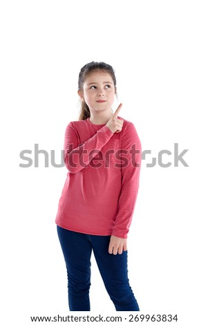 Portrait of young girl pointing at copyspace on white background - stock photo