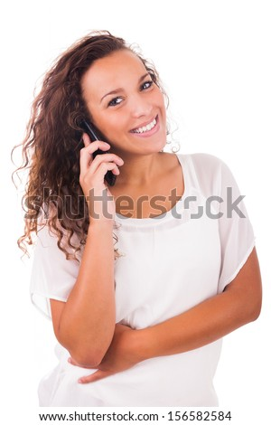 Portrait Of Young Girl talking On phone isolated - stock photo