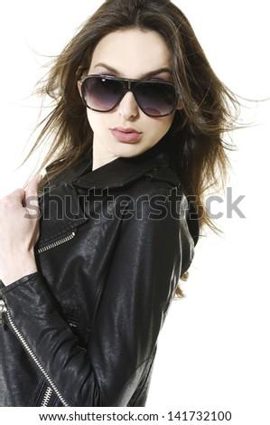 Portrait of young girl wearing stylish sunglasses - stock photo