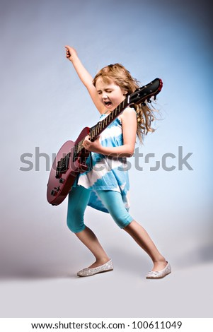 portrait of young girl with a guitar on the stage