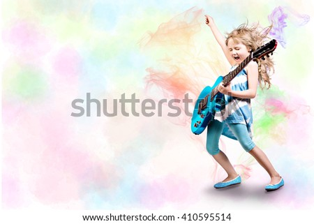 portrait of young girl with a guitar on the stage - stock photo