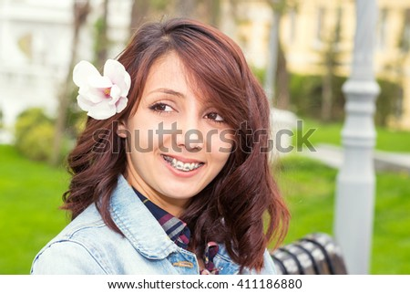 portrait of young girl with braces outdoor