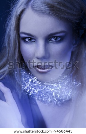 Portrait of young girl with bright make-up.fashion art.magic blue light.