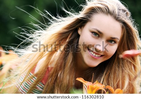Portrait of young girl with flower - stock photo