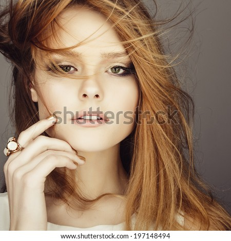 Portrait of young girl with red hair in a studio, closeup - stock photo