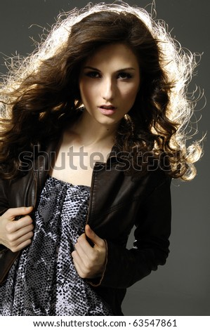 Portrait of young girl with smart fair hair on light background - stock photo