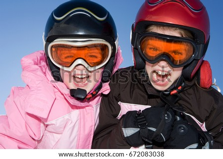Portrait of young girls in ski kit