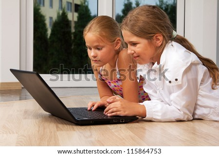 Portrait of young girls playing games on computer