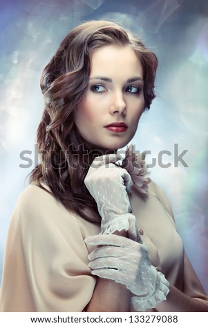 Portrait of young glamorous woman on sparkling background in old Hollywood style - stock photo