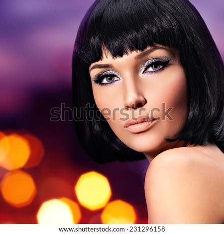 Portrait of young glamour woman with a  fashion bright makeup of eyes  - art background - stock photo