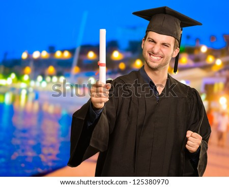 Portrait Of Young Graduation Man, Outdoor