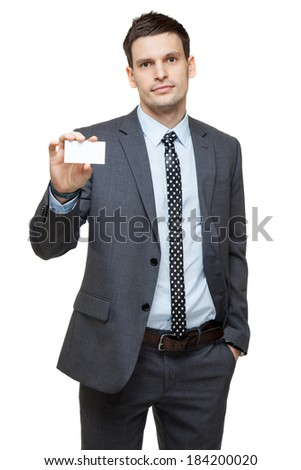 Portrait of young handsome businessman. showing business card. Isolated on white. - stock photo