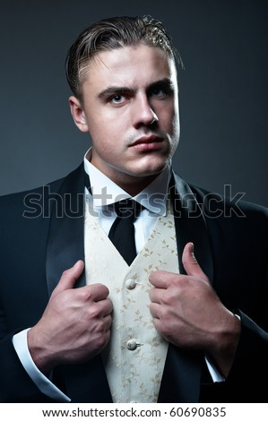 Portrait of young handsome groom in suit - stock photo